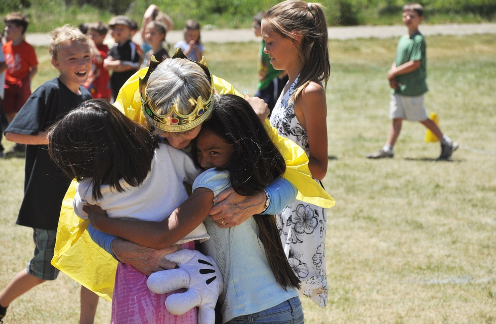 Strawberry Park Elementary School Principal Dunham gets hugs from some of her students Thursday on the last day of school. After serving the Steamboat Springs School District for 34 years, Dunham now is looking forward to her retirement.