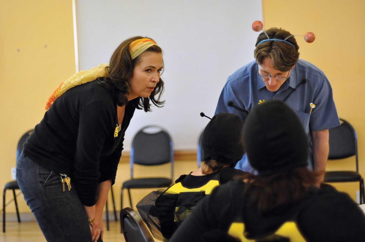 Council on Aging Executive Director Laura Schmidt, left, and Michael David Bauk confer with other Community Spelling Bee organizers Saturday to settle a spelling dispute.