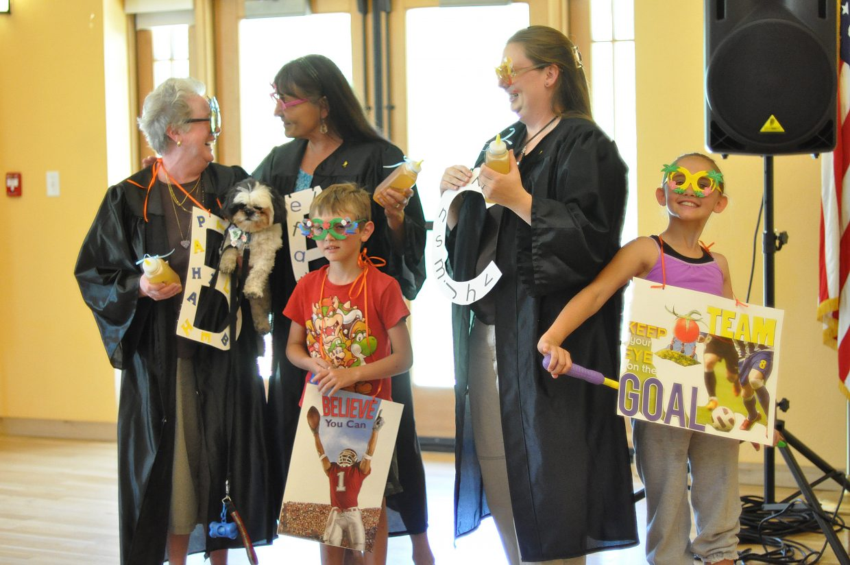 The Bee Attitudes celebrate Saturday after winning the costume contest at the Community Spelling Bee. Pictured are, back row from left, team members Tanna Brock with dog Colt, Stacey Libby and Nicole Moore and, front row from left, Austin Moore, 7, and Cassidy Moore, 8.