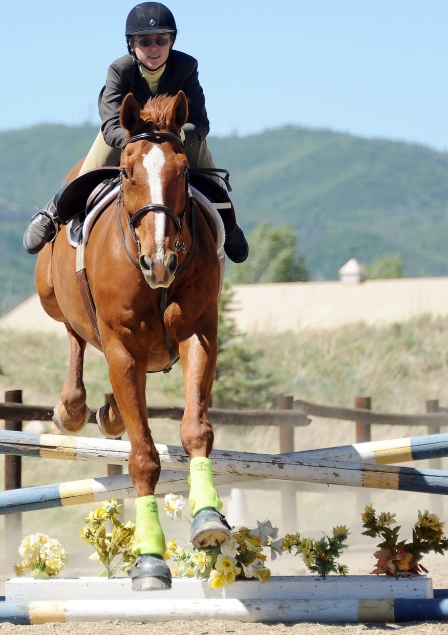 Brittany Brown and Willie clear an obstacle Saturday at the Cayuse Classic.