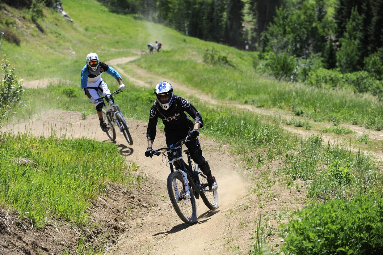Lance Canfield, front, and Steamboat Ski Area employee Brandon Arce come down the lower Rustler Ridge trail Saturday at Steamboat Ski Area.