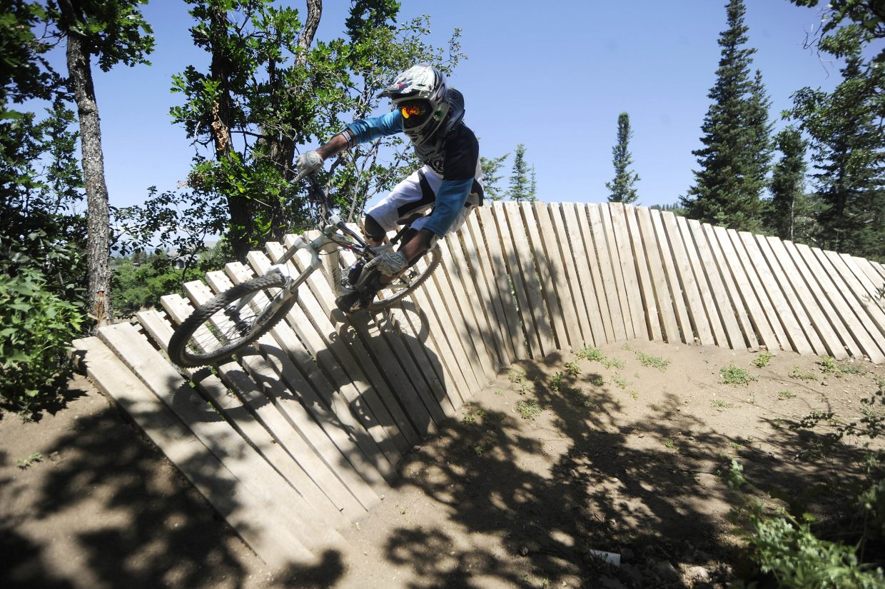 Steamboat Ski Area employee Brandon Arce comes around a wooden berm Saturday at the ski area's bike park.