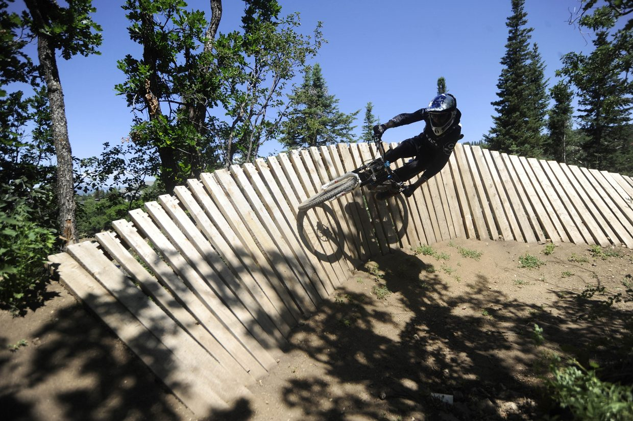 Lance Canfield comes around a wooden berm Saturday at Steamboat Ski Area's bike park.