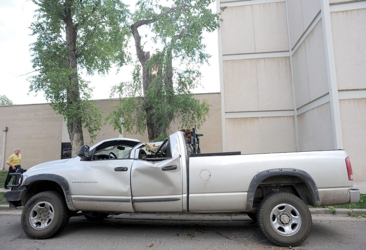 A brief but fierce wind storm blew through Steamboat Springs on Monday. This Dodge pickup suffered extensive damage when a tree fell on it on Oak Street.