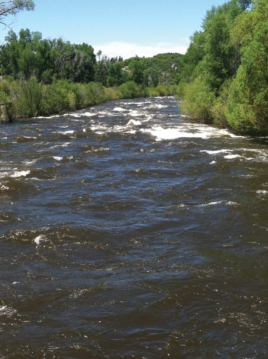 The Yampa River flows downstream from the Fifth Street Bridge on Sunday, June 12.
