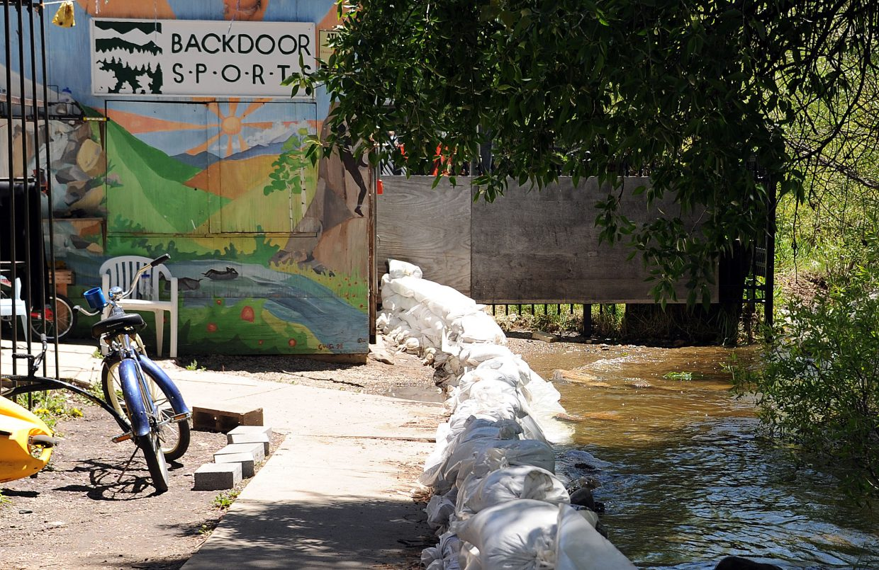 The Yampa River laps at the back door of Backdoor Sports in Steamboat Springs.