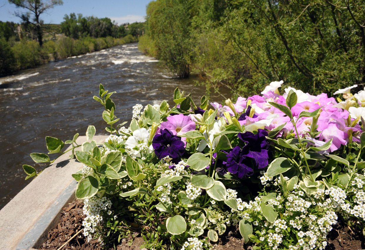 Water rolls down the Yampa River past the 5th Street Bridge on Sunday in Steamboat Springs.