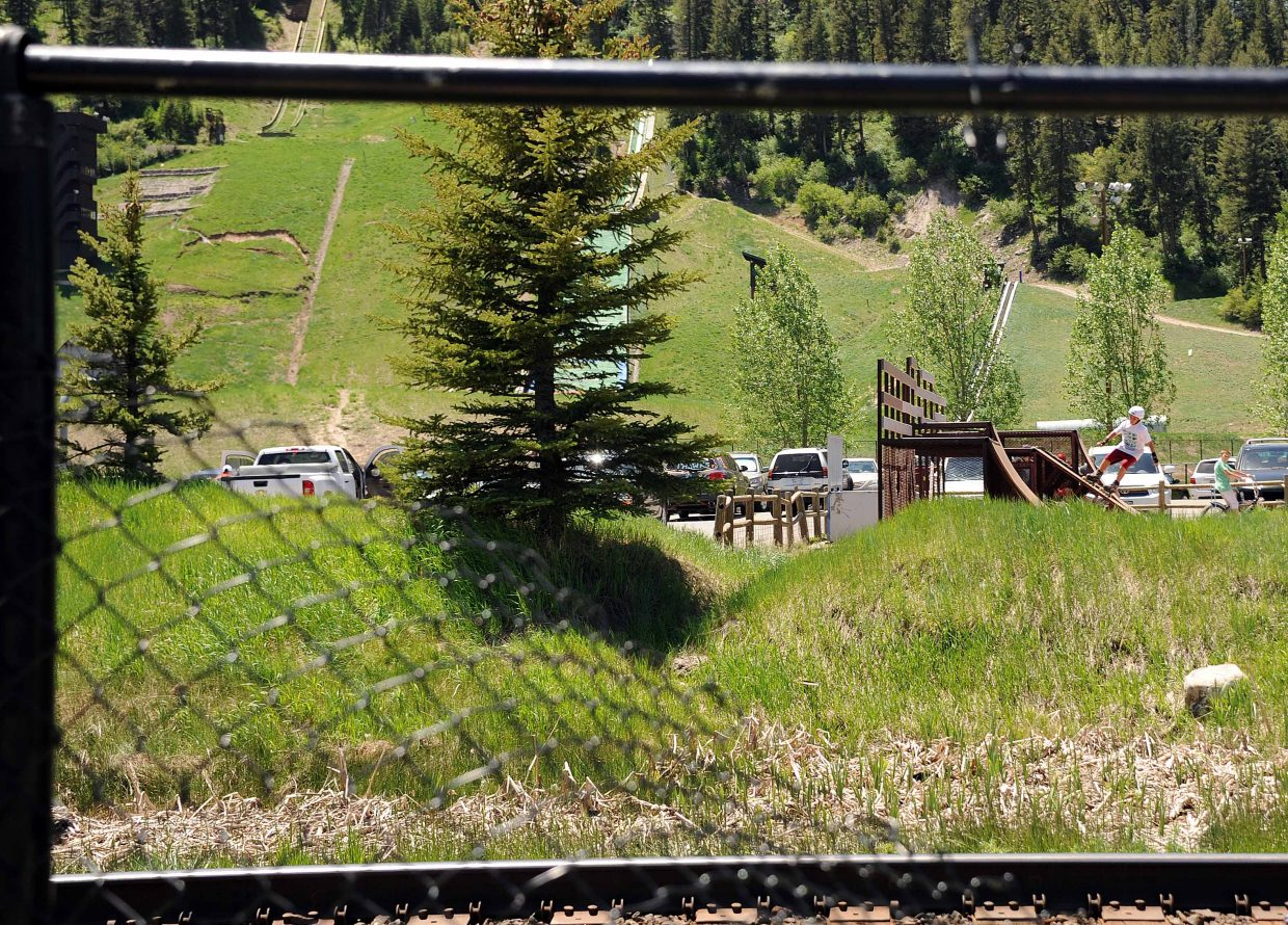 A hole in a fence offered a way around a flood section of the Yampa River Core Trail in downtown Steamboat Springs on Sunday.