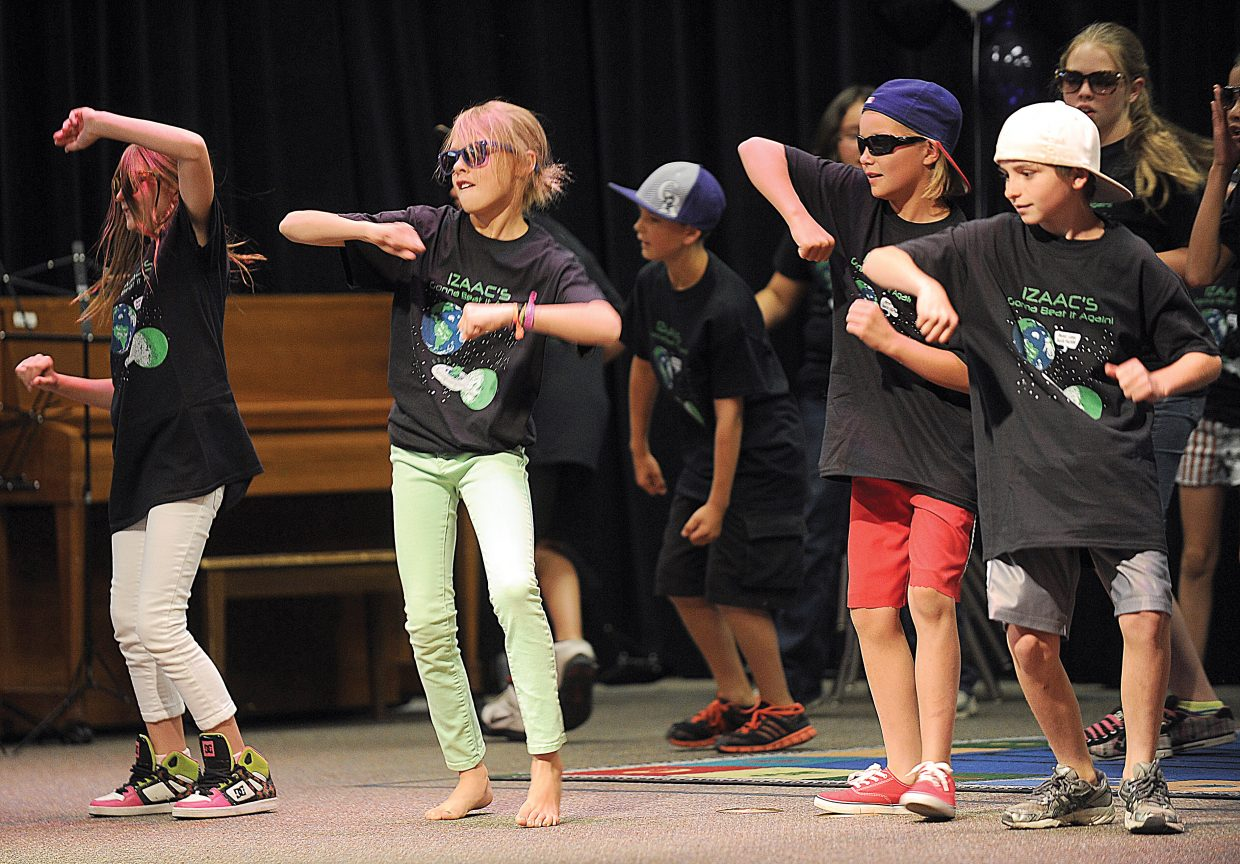 Kirra Kusy and her classmates in Mrs. Kline's fifth-grade class dance as part of the 2013 Soda Creek Elementary School talent show on the final day of class.