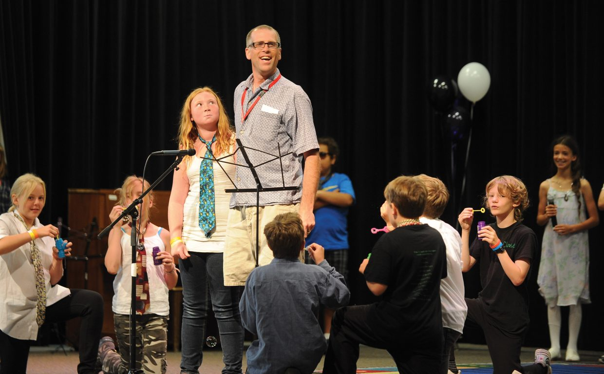 Fifth-grade teacher Andrew Miller and his students, including Bantle Gibbs, right, perform as part of the 2013 Soda Creek Elementary School talent show on the final day of class.