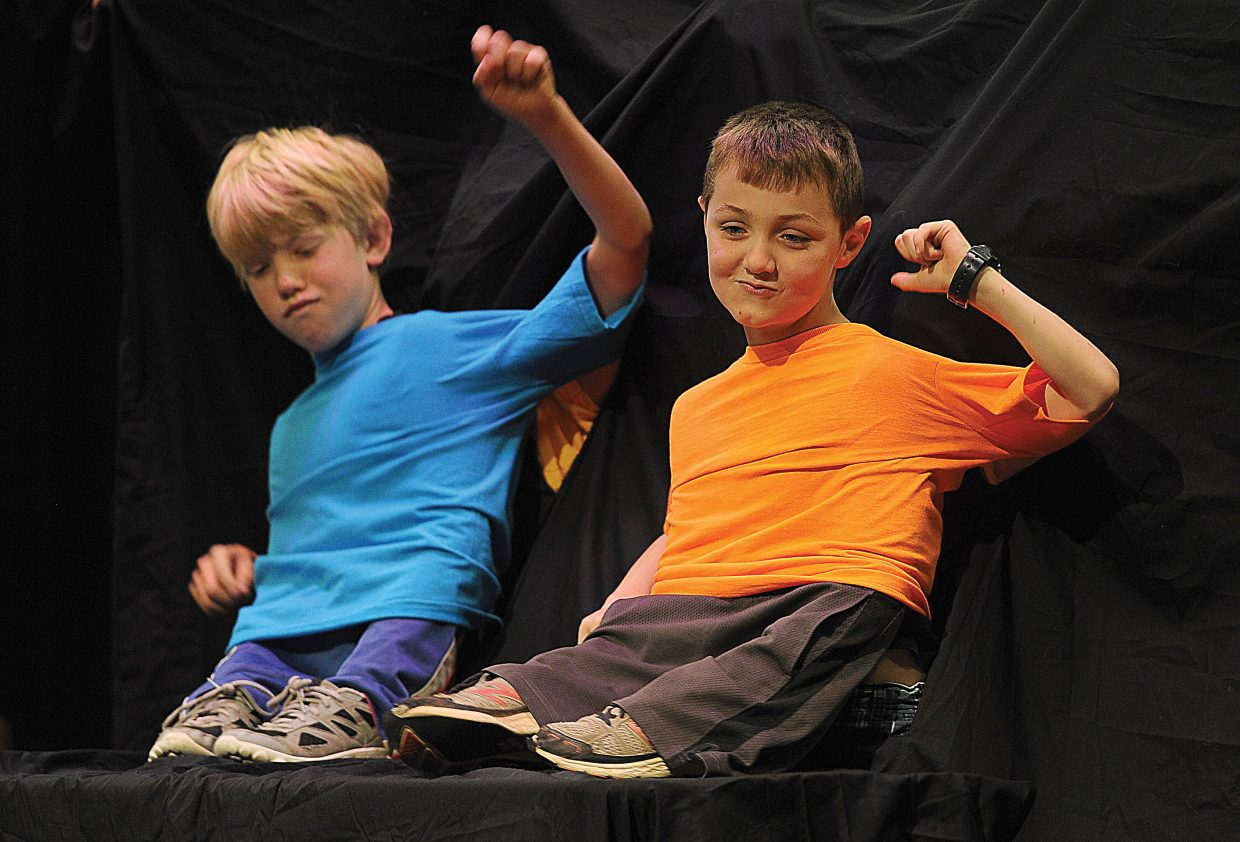 Soda Creek Elementary School students Quinn Dorris, right, and Daniel Kempers perform a skit Wednesday as part of a talent show at the school. The pair was given a hand — really, an arm — by classmates Alan Duty and Jaydon Fryer, who were hidden behind the backdrop.