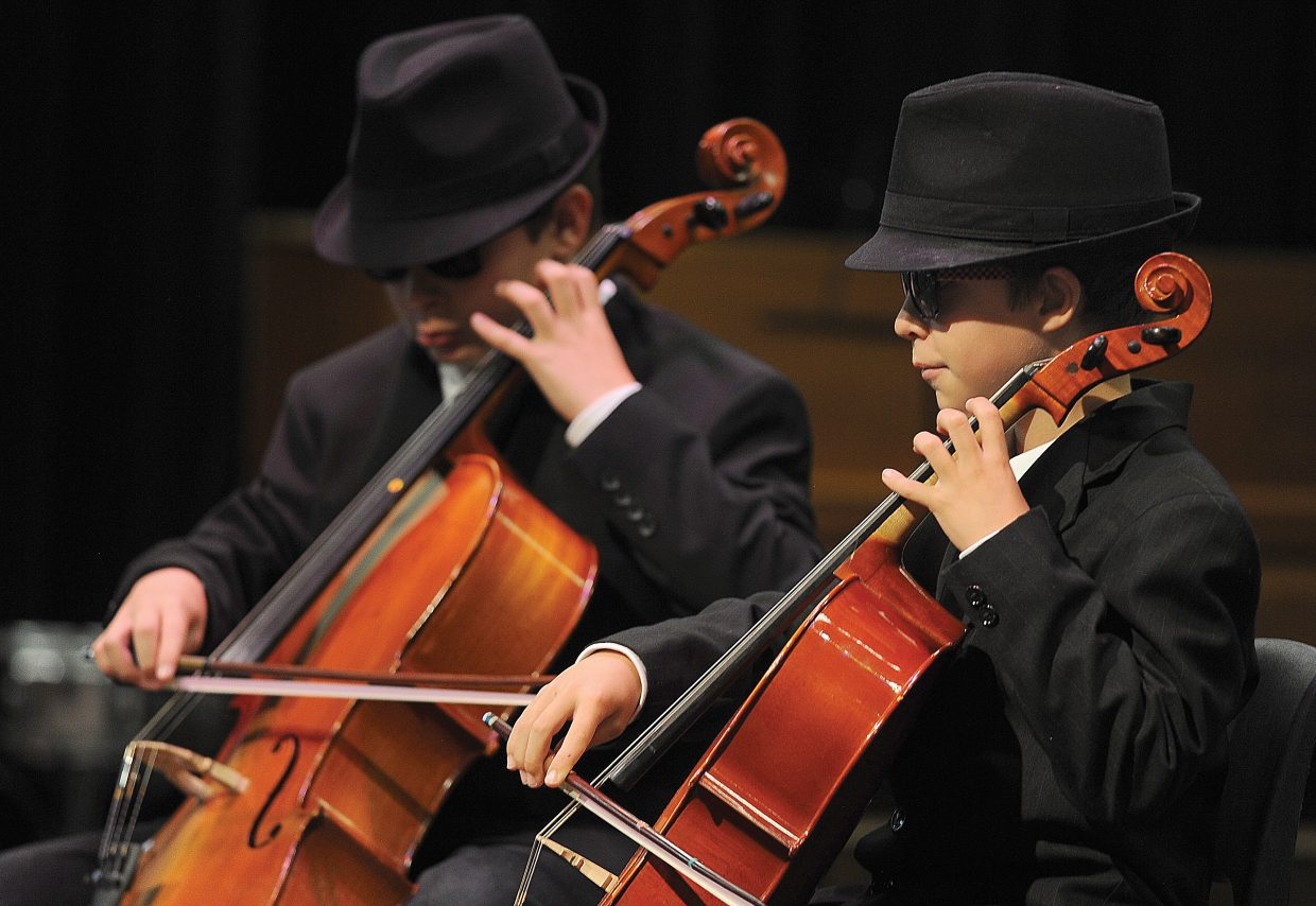 "Soda Creek Elementary School students George, right, and John Slowey play ""Rigadoon"" on their cellos Wednesday as part of the school's talent show."
