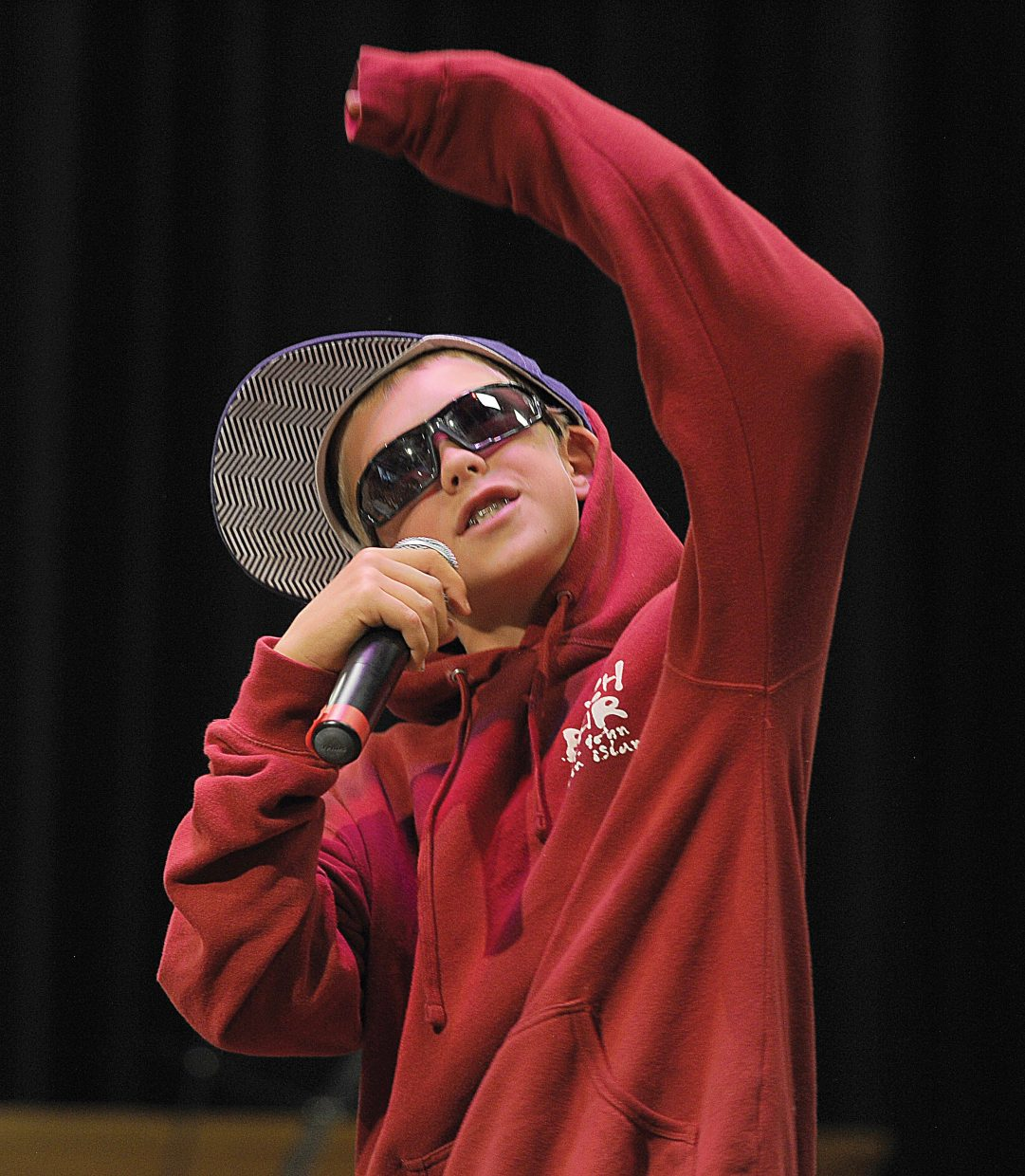 """Soda Creek Elementary School student Jack Colfer performs a vocal parody titled """"Never Say Never"""" on Wednesday morning as part of the school's talent show."""
