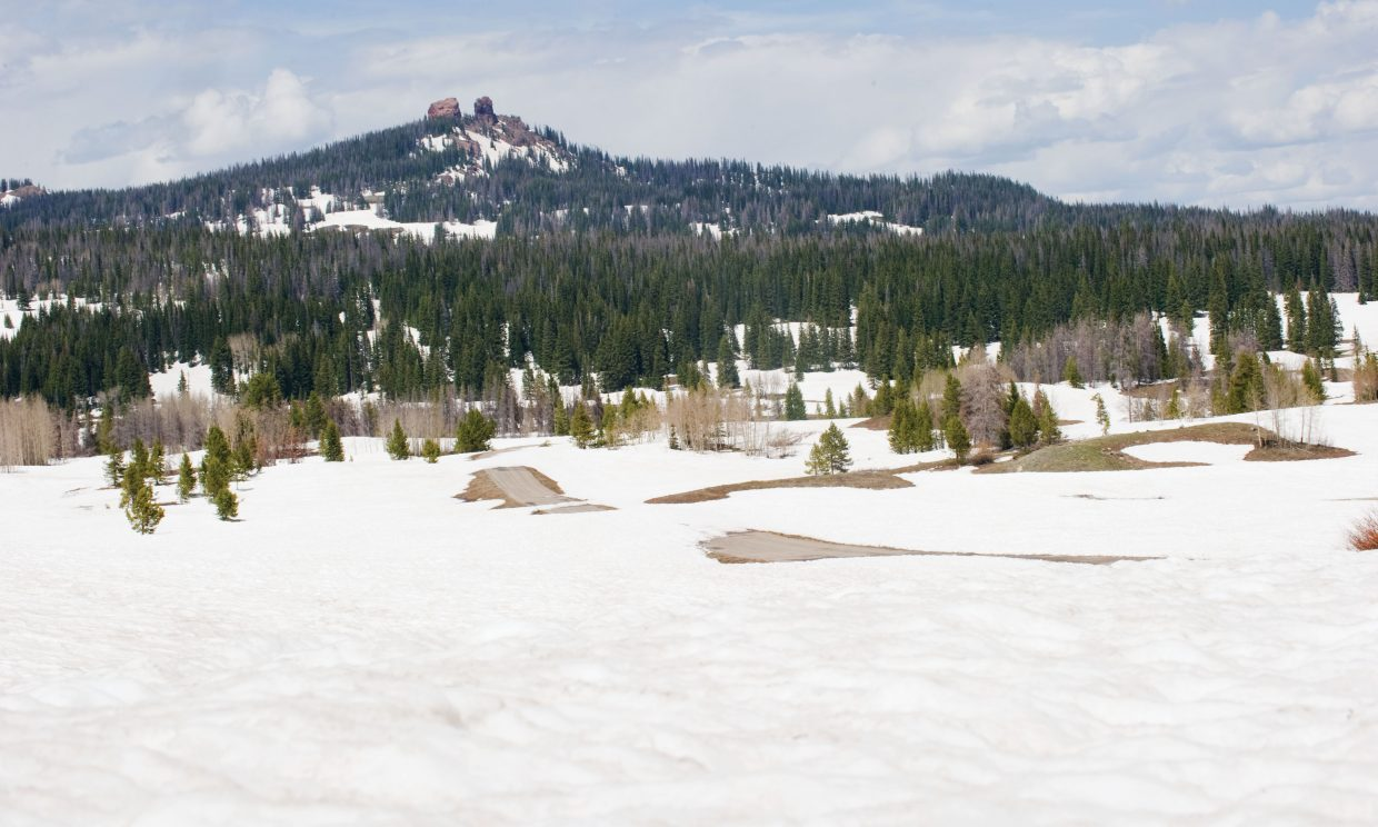 Patches of the pavement on the road leading to Dumont Lake near Rabbit Ears Pass have melted, but most of the area still is covered with 6 inches to a foot of snow. Warmer weather has taken a toll on the snowpack at higher elevations, but local streams and rivers should continue to run high.
