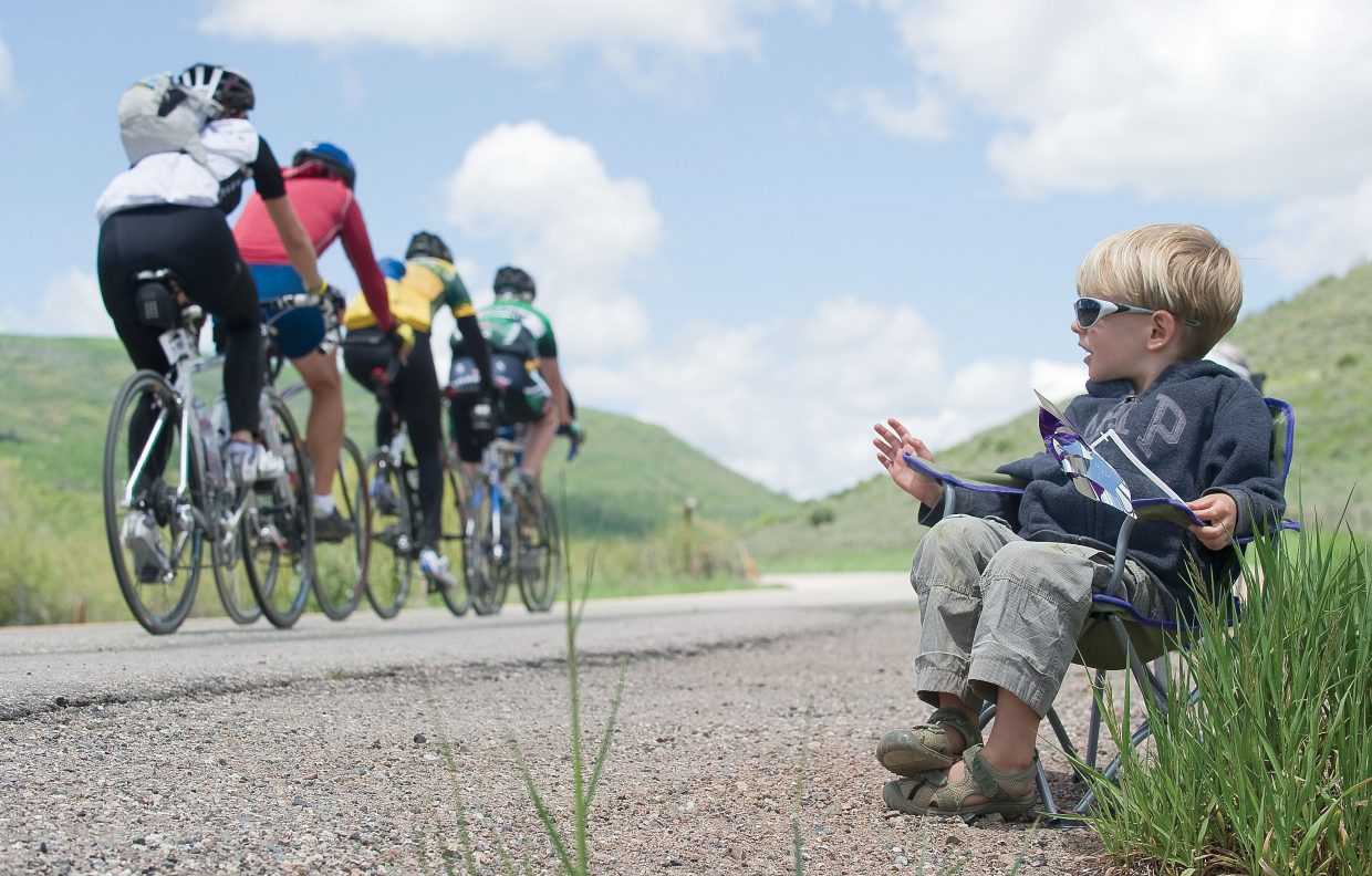Simon Rittner cheers for cyclists making their way from Edwards to Steamboat Springs as part of the third day of the Ride the Rockies bicycle tour Tuesday near Stagecoach Reservoir. The bike tour will call Steamboat Springs home for two days. The 2,000 cyclists on the tour will take part in a loop ride Wednesday before leaving for Granby on Thursday morning.