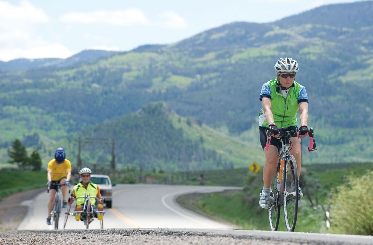 Denver resident Susan Mitchell makes her way up a long climb near Stagecoach Reservoir on Tuesday afternoon during the Ride the Rockies bicycle tour. The 412-mile bike tour will call Steamboat Springs home for two days. The 2,000 cyclists on the tour will take part in a loop ride Wednesday before leaving for Granby on Thursday morning.