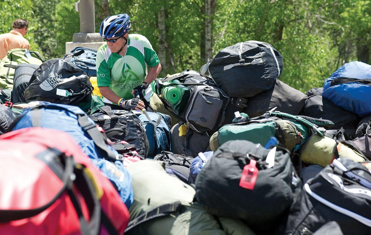 David Aker, of Blackhawk, looks for his luggage after arriving in Steamboat Springs on Tuesday afternoon. Aker was one of the more than 2,000 cyclists taking part in this year's Ride the Rockies.