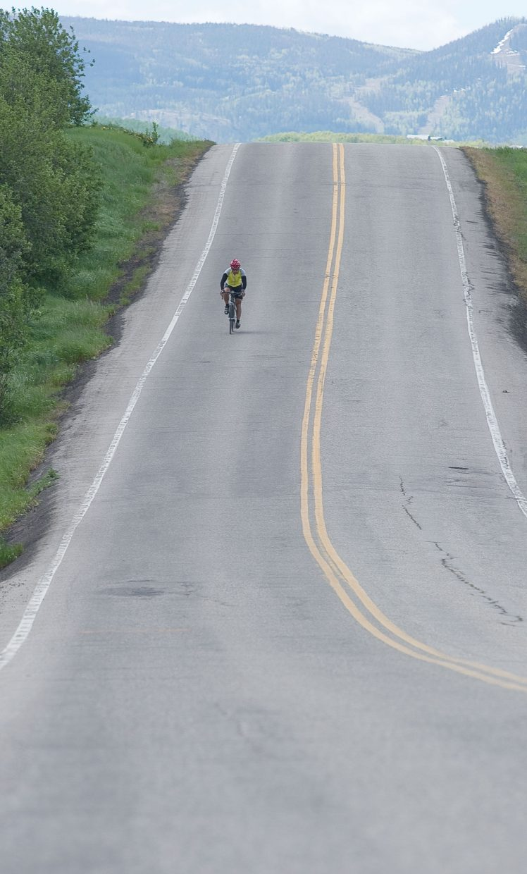 A lone cyclist makes his way along Routt County Road 14 on his way from Edwards to Steamboat Springs Tuesday as part of Ride the Rockies bicycle tour.
