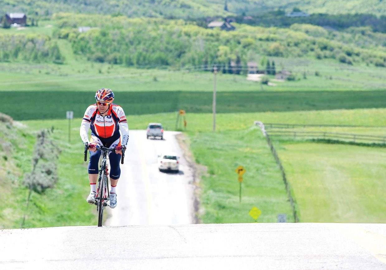 Cyclist Charley Dickey makes his way along Routt County Road 14 on his way from Edwards to Steamboat Springs Tuesday as part of Ride the Rockies bicycle tour. The 412-mile bike tour will call Steamboat Springs home for a few days. The tour will take part in a loop ride to Oak Creek Wednesday before leaving for Granby Thursday morning.