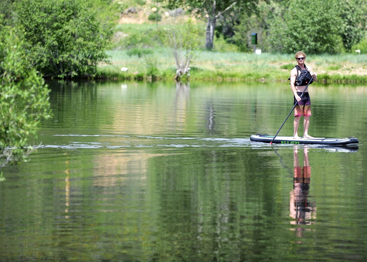 This spring, Steamboat Springs residents Dmitri Brown and Anne Zoltani (not pictured) started the Bodhi Sup all-intensive stand-up paddleboarding company. They offer lessons, guided tours down the river and on lakes as well as fitness classes.