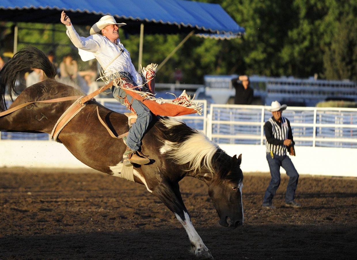 Kyle Weides, of Laramie, Wyoming, competes in the bareback riding competition during the Steamboat Springs Pro Rodeo Series season opener Friday night at the Brent Romick Rodeo Arena. The rodeo begins at 7:30 p.m. every Friday and Saturday throughout the summer and at 6:30 p.m. July 4.