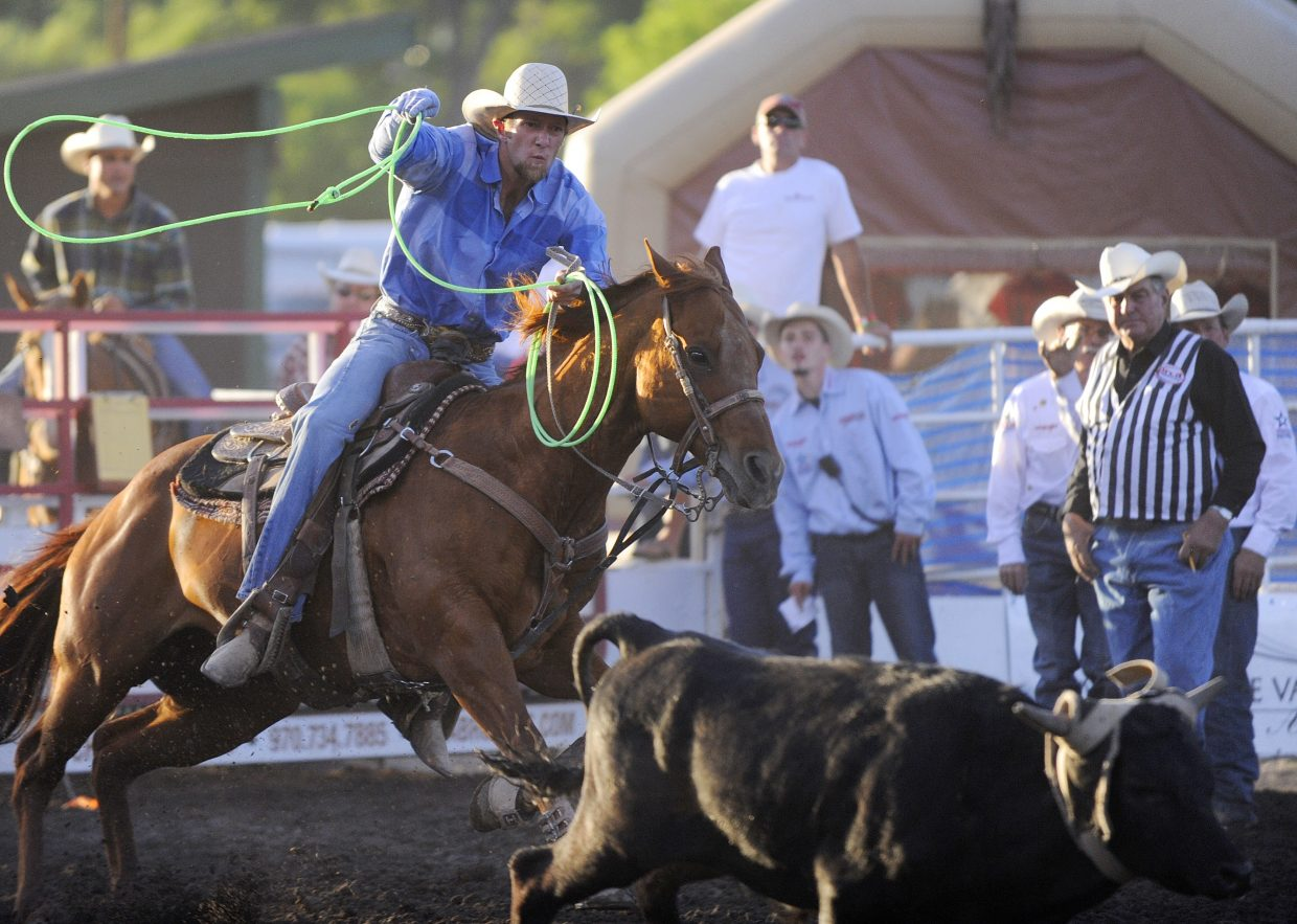 Jace Hutton, of Loma, competes in the team roping competition during Steamboat Springs Pro Rodeo Series season opener rodeo Friday night at the Brent Romick Rodeo Arena. The rodeo begins at 7:30 p.m. every Friday and Saturday throughout the summer and at 6:30 p.m. July 4.