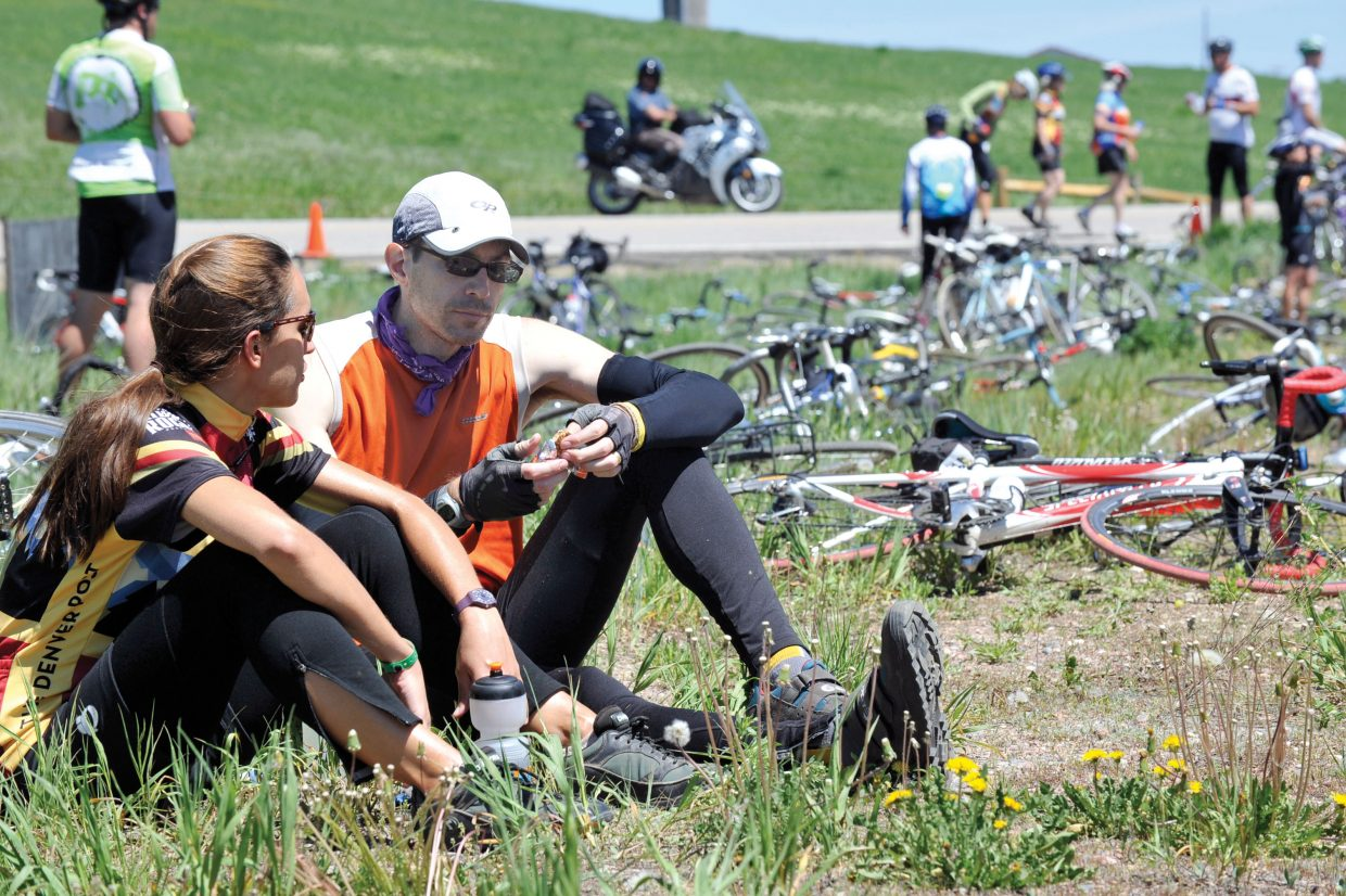 Lucy McClellan and Joe Beaird take a break during Ride the Rockies on Wednesday.
