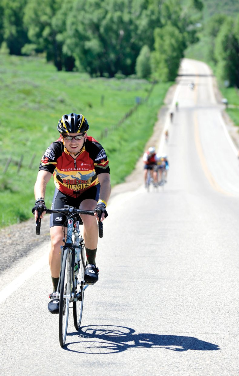 Andrew Collins makes his way up a hill on Routt County Road 33 during Ride the Rockies on Wednesday afternoon.