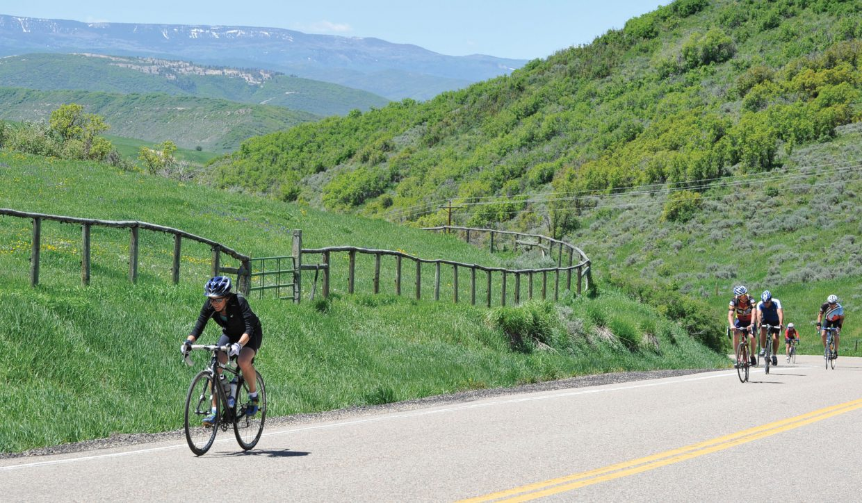 Leslie Gottfried makes her way on a long climb on Routt County Road 33 during Wednesday's Ride the Rockies route.