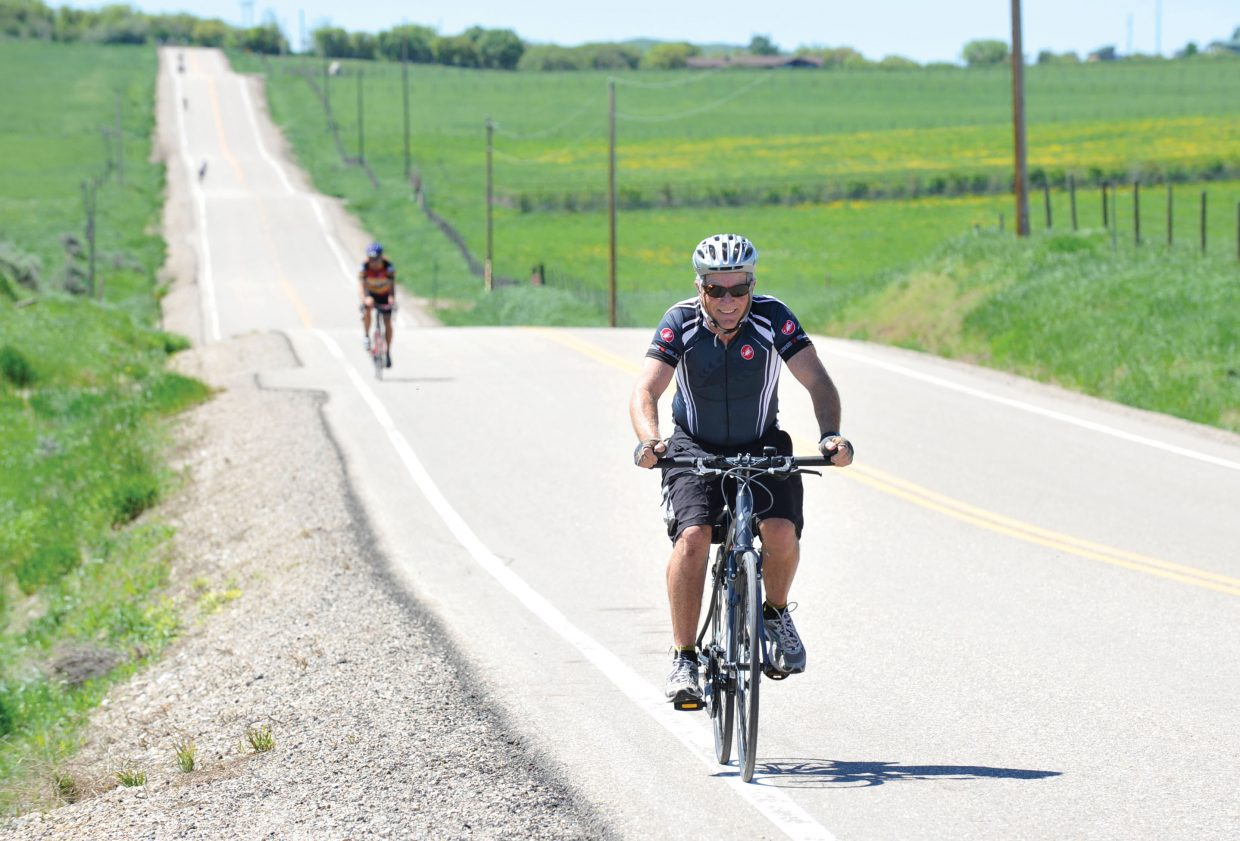 Cyclist Steve Green makes his way along Routt County Road 33 on Wednesday.