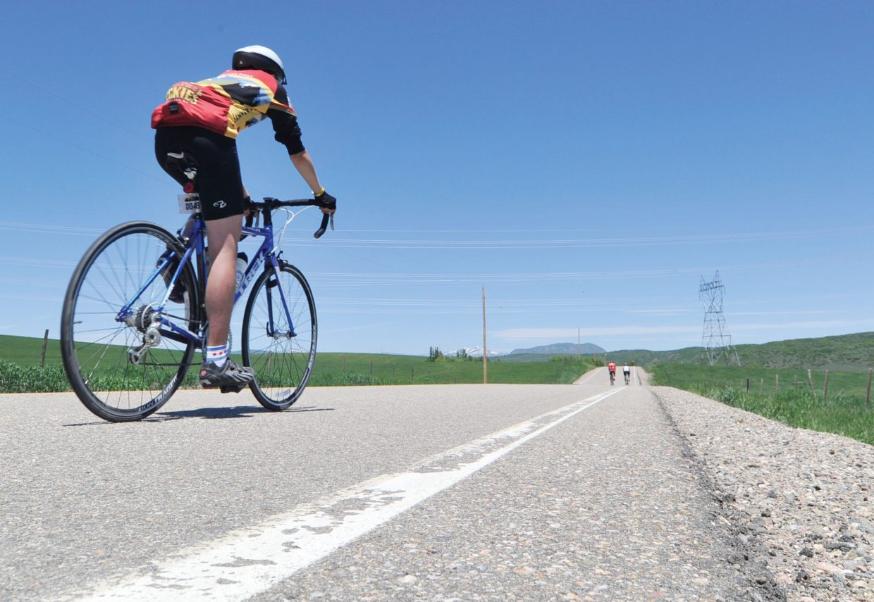 A cyclist heads for Steamboat Springs on Wednesday during Day 4 of the Ride the Rockies bicycle tour.
