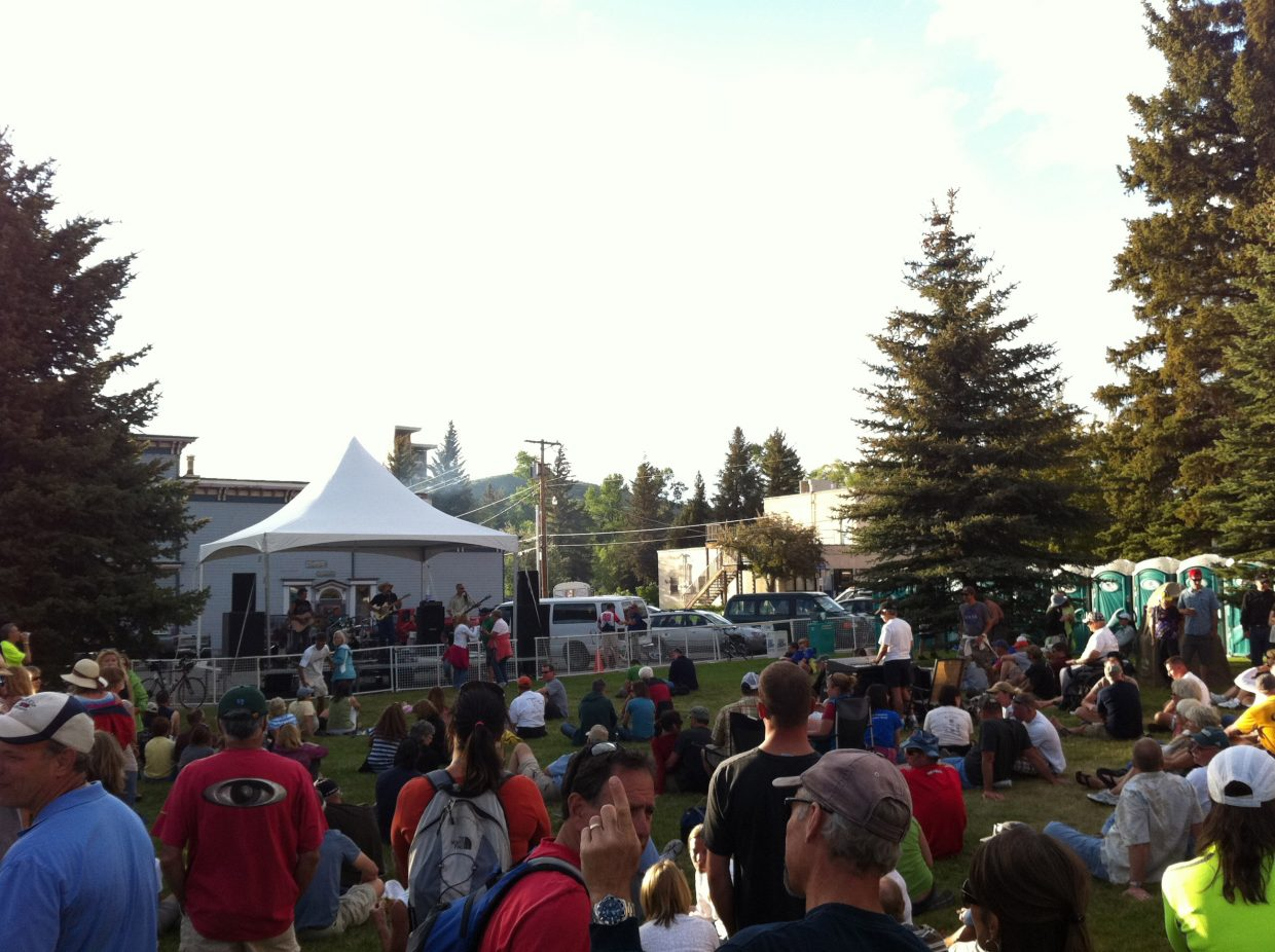 Steamboat residents and visitors enjoy a beer garden and free concert by Loose Change on the Routt County Courthouse lawn as part of Ride the Rockies on Wednesday.