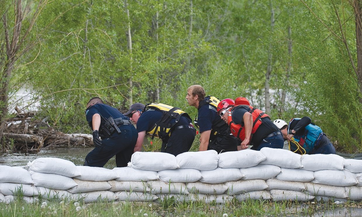 Steamboat Springs police, Routt County Sheriff's Office deputies, Routt County Search and Rescue members and Steamboat Springs Fire Rescue members pull a man from the waters of the Yampa River on Wednesday afternoon. Witnesses said the man fell into Soda Creek near Lincoln Avenue and 12th Street at about 4 p.m., launching a multi-agency search and rescue effort. He was found 50 minutes later near Sleepy Bear Mobile Home Park.