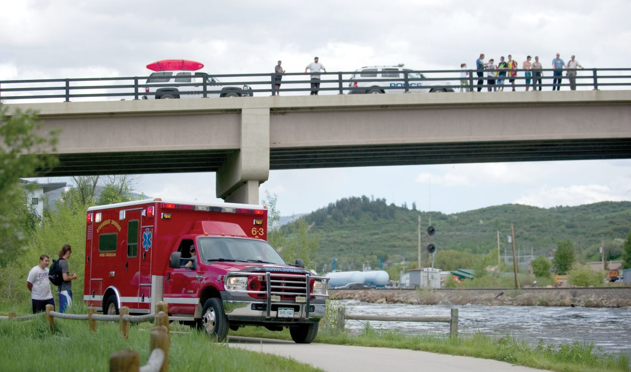An ambulance waits along the Yampa River Core Trail on Wednesday afternoon as members of the Steamboat Springs Police Department, Routt County Sheriff's Office, Routt County Search and Rescue and Steamboat Springs Fire Rescue search for a man who fell into Soda Creek before being swept into the Yampa River. The man died in what police say was probably a cold-water drowning.