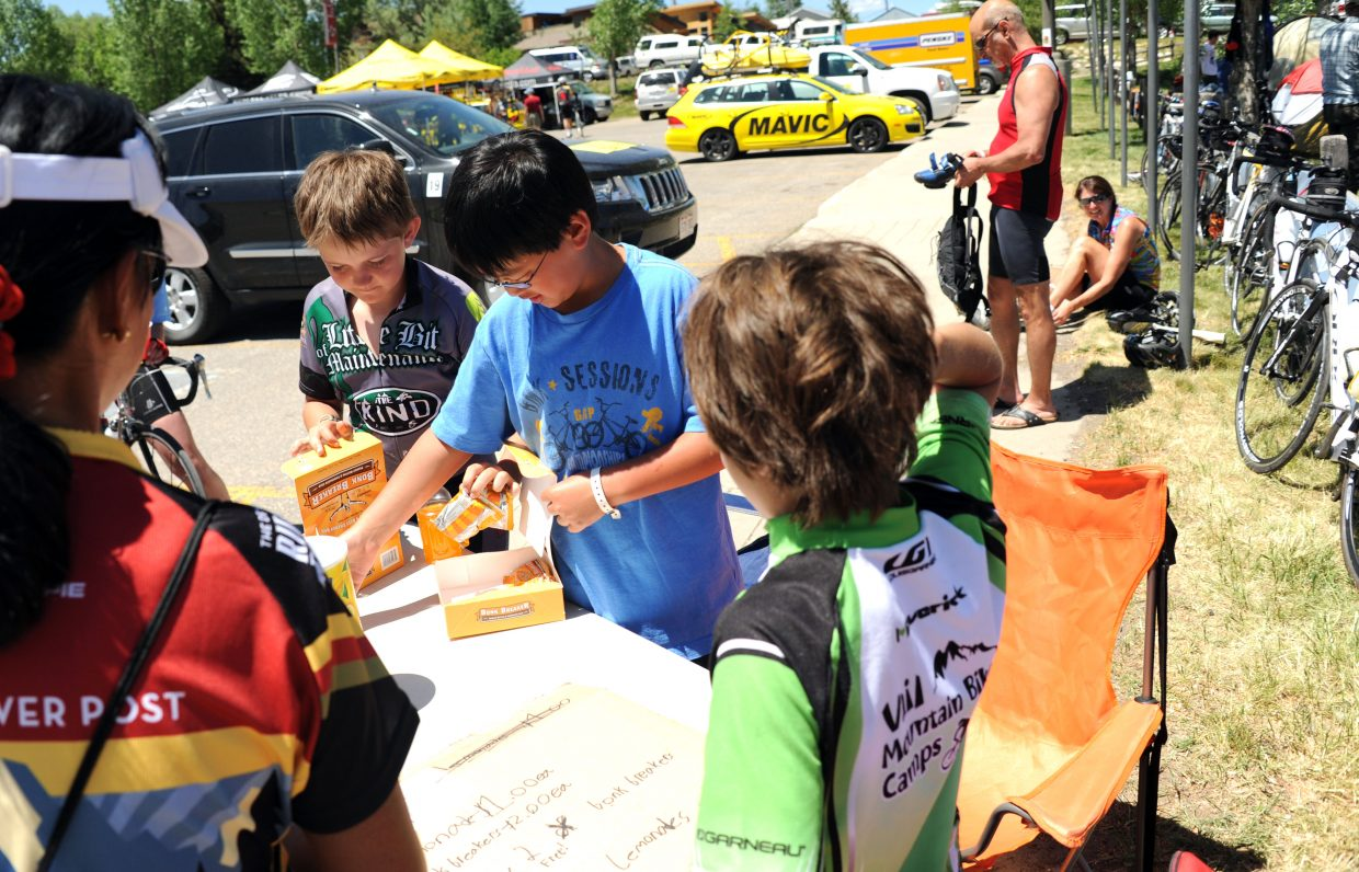 Elementary school classmates from Vail, David Sandberg, from right, Kiernan Davis and Garrett Sampson, all 10, pack up a box of energy bars for a customer Wednesday at their lemonade stand in front of Steamboat Springs High School.