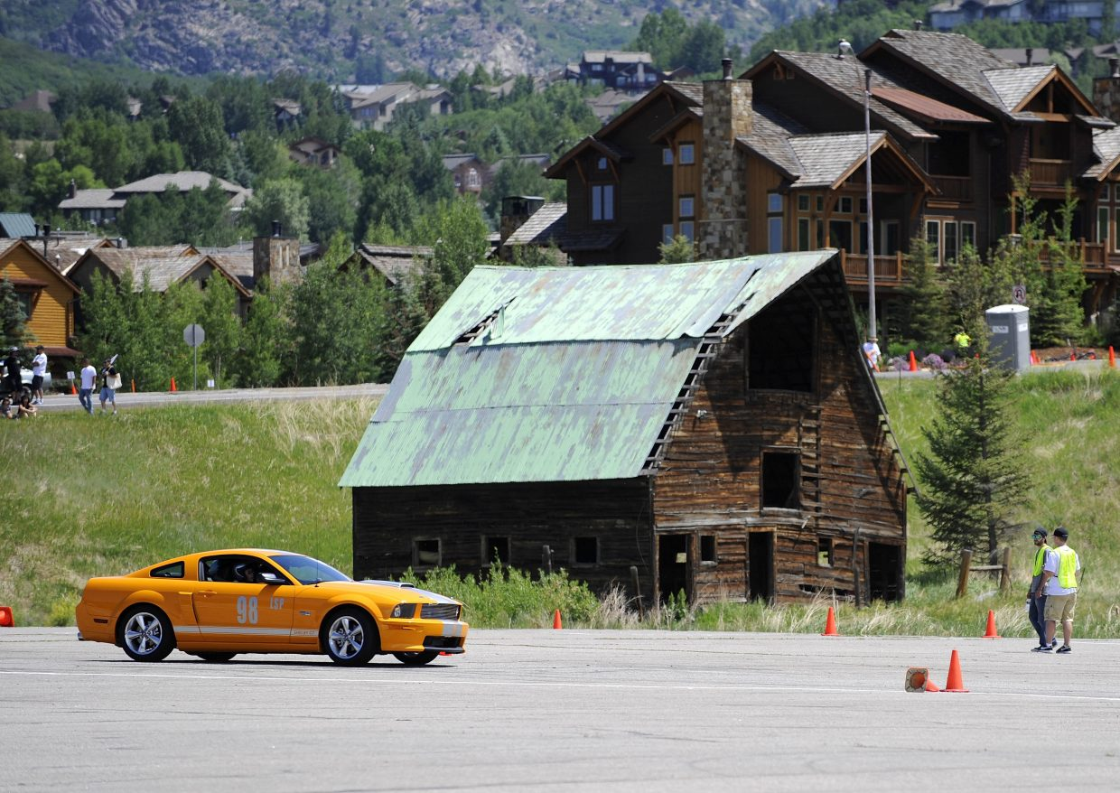 Greg Sheehan, of Denver, drives his 2008 Ford Mustang Shelby GT around an autocross course at the Meadows Parking Lot in Steamboat Springs during Friday's Mustang Rally. The Mustang Roundup Show 'n' Shine is from 10:30 a.m. to 3 p.m. Saturday on Lincoln Avenue in downtown Steamboat.