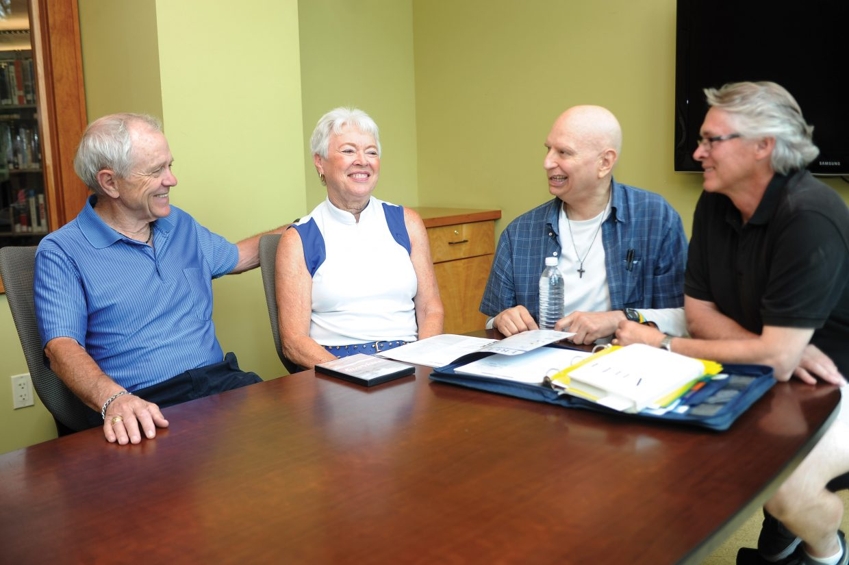 Ken Farmer, second from right, meets with cancer coaches, from left, Ron Pollard, Lois Pollard and Jan Kaminski. Farmer helped start Yampa Valley Heals, a group to support other cancer patients or survivors in the valley.