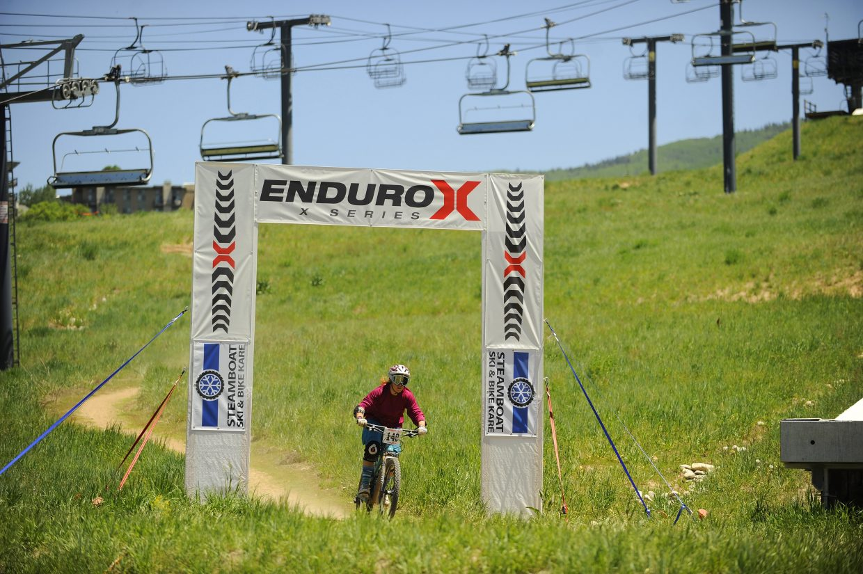 Amy Scherm crosses the finish line while competing in the Enduro-X race Saturday at Steamboat Ski Area. She finished second among women in 55:19.43