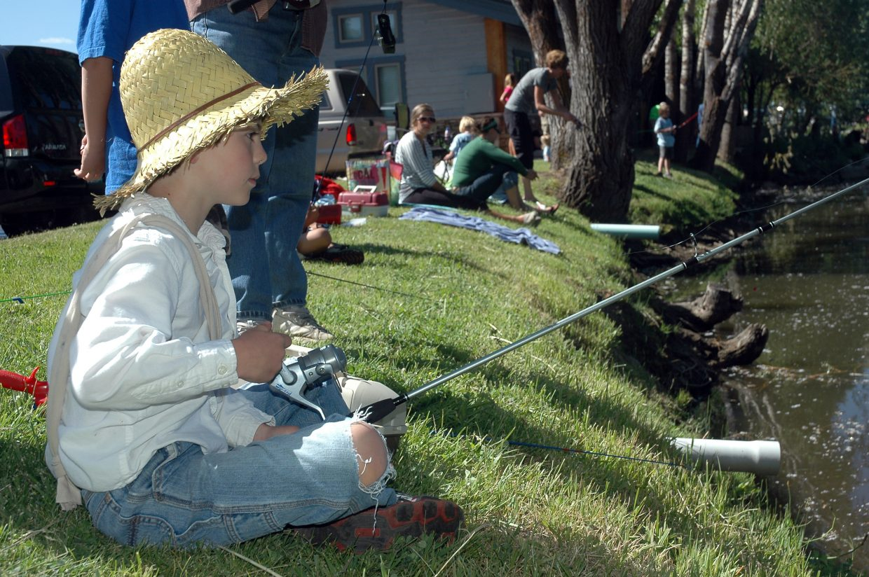 Christopher Stone, 9, of Steamboat Springs, dressed up as Huck Finn for the Fishing Derby on Saturday at Walton Pond. He won a costume contest for his outfit.