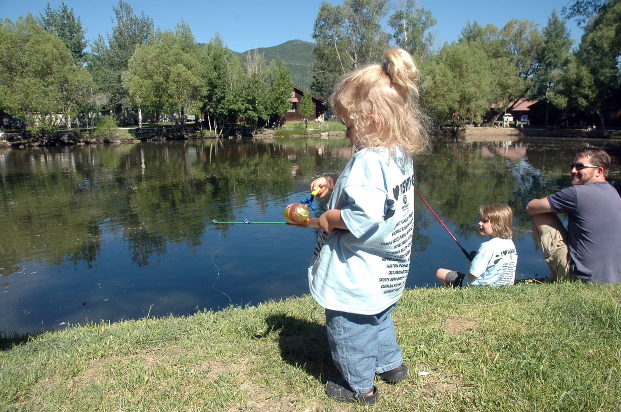 Lorelai Hill, 3, of Westminster, learns to cast for the first time at Saturday's Optimist Club Fishing Derby.