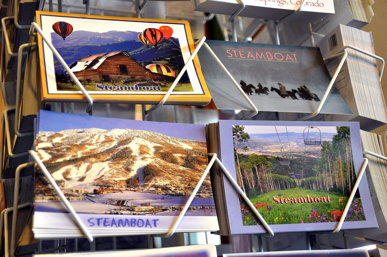 Postcards marketing Steamboat Springs in all seasons greet shoppers at the Steamboat Treasures & Tees store on Lincoln Avenue.