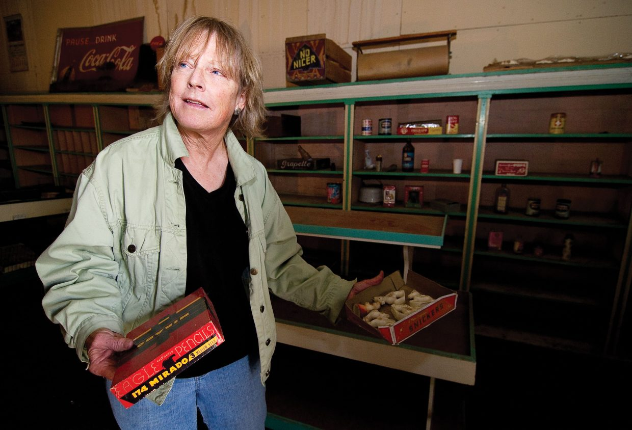 Wendy Moreau, Yampa resident and curator of Yampa Historical Museum, shows off some of the items that were found inside the Crossan's Market building. The Friends of Crossan's group is hoping to restore the historic building in downtown and preserve part of the town's rich history in the process.