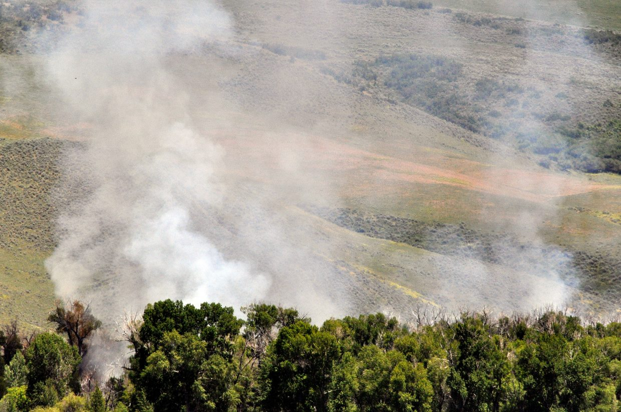 A wildfire burns at the Carpenter Ranch just east of Hayden. West Routt Fire Chief Bryan Rickman said the fire has grown from half of an acre to five acres, but still is not threatening any structures.