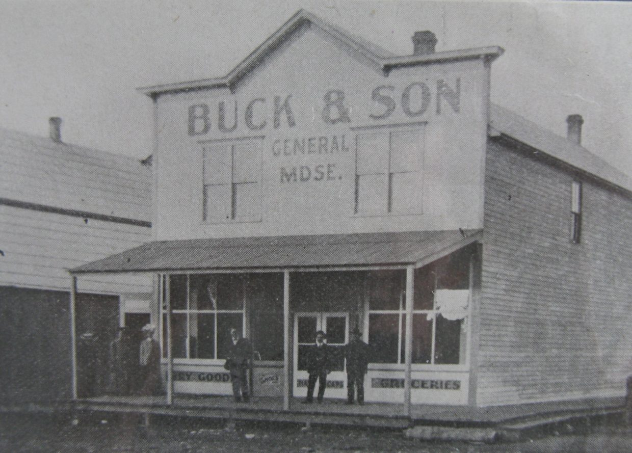 This early 1900's photo was taken outside Buck & Son in downtown Yampa. The building, which now is called Crossan's Market, is being restored by a group called Friends of Crossan's.