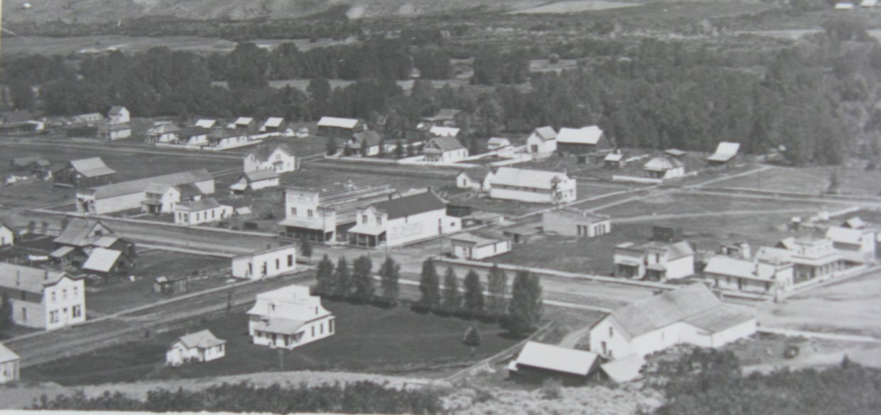 The town of Yampa is shown here in the 1920s. Crossan's Market is located in the top left corner of the main intersection.