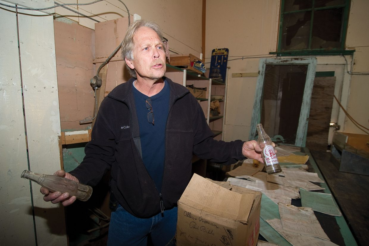 Jeff Drust holds some old soda bottles that were found inside the Crossan's Market building. Drust is president of the Friends of Crossan's a group that is hoping to restore the historic building in downtown.