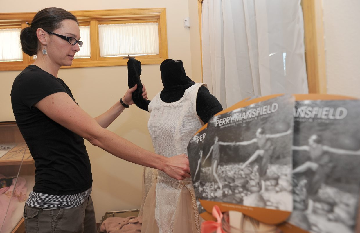 Katie Adams sets up a display celebrating Perry-Mansfield Performing Arts School and Camp's 100 years in Steamboat Springs The display will open to the public Friday. The museum is open from 11 a.m. to 5 p.m.