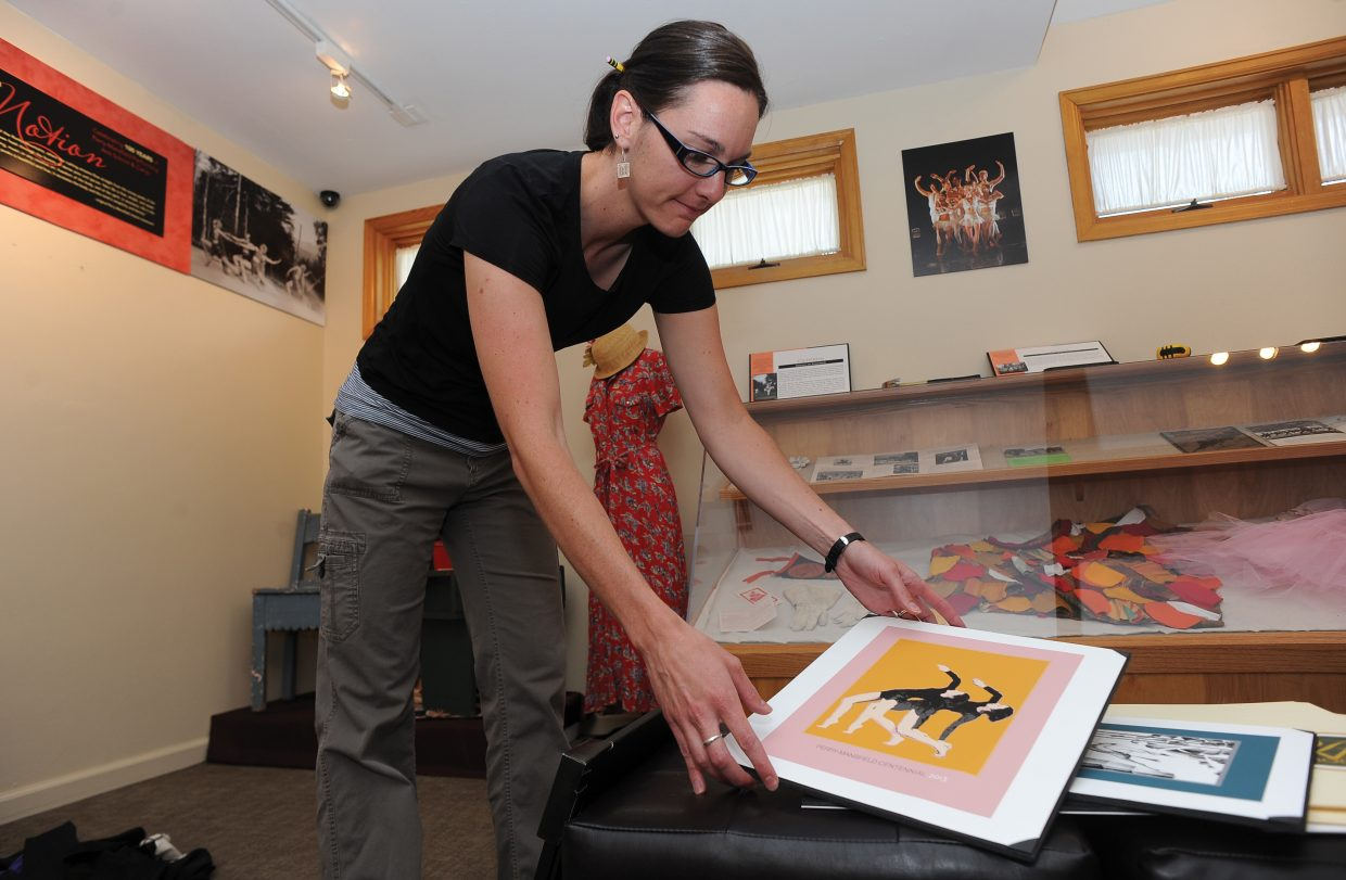 Katie Adams sets up a display celebrating Perry-Mansfield Performing Arts School and Camp's 100 years in Steamboat Springs. The display will open to the public Friday. The museum is open from 11 a.m. to 5 p.m.