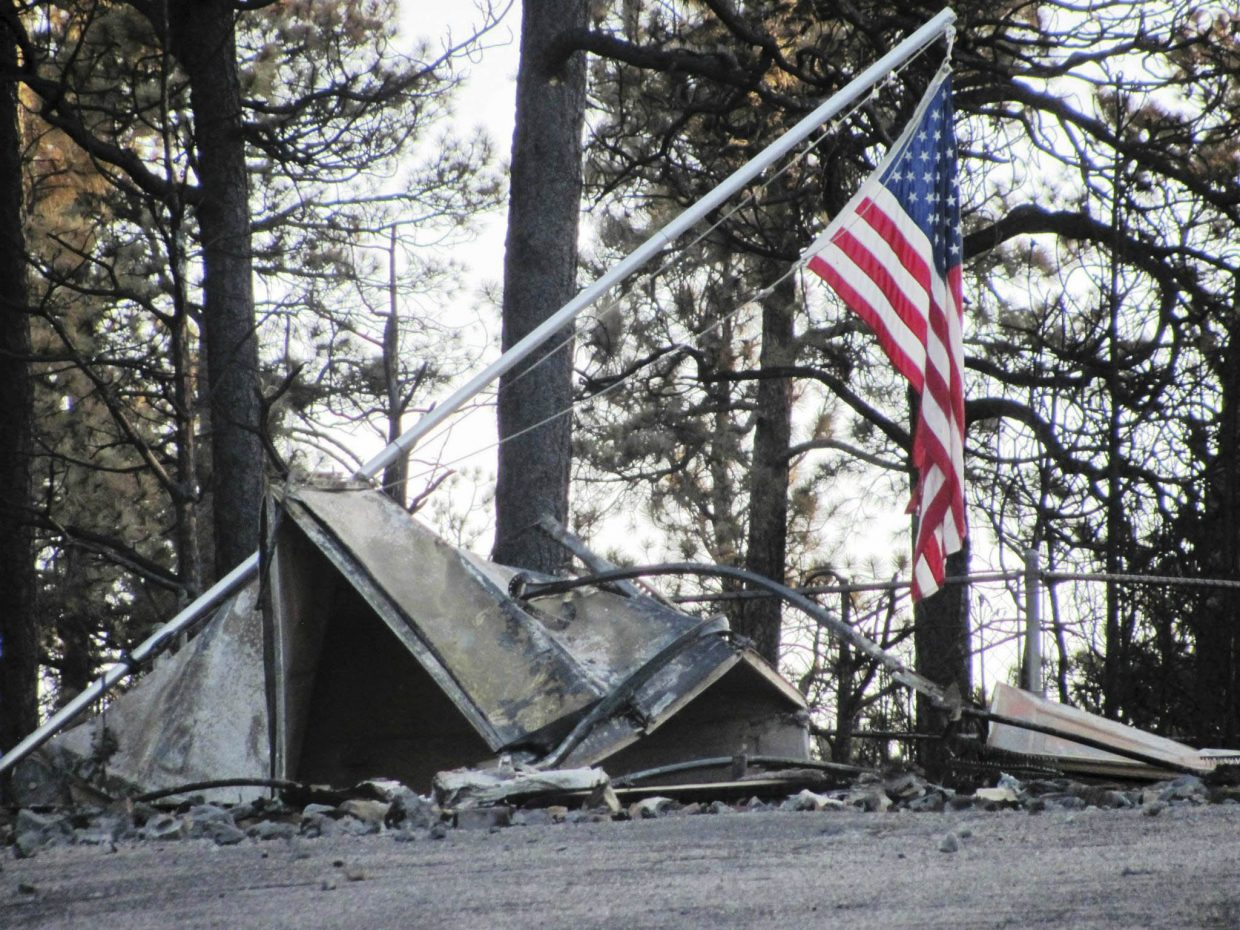 The local firefighters righted this flag they found lying on the ground amidst the destruction at the Black Forest Fire.