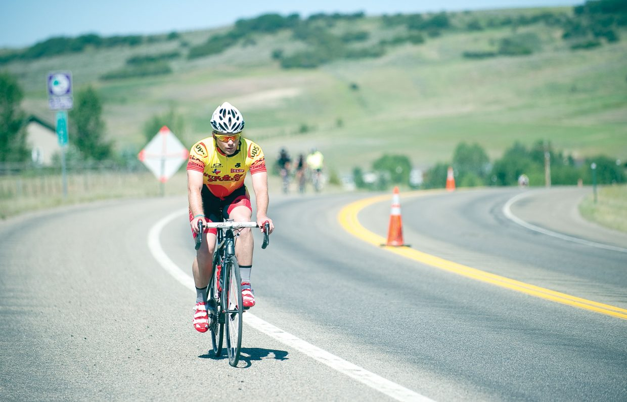 James Privett, of Houston, rides his bike along U.S. Highway 40 on Wednesday morning during the Bicycle Tour of Colorado. More than 1,200 cyclists are taking part in the ride, which came to Steamboat Springs on Wednesday.